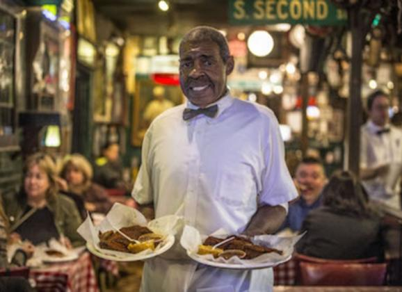 Serving up famous Memphis barbecue at Rendezvous. Photo by Craig Thompson