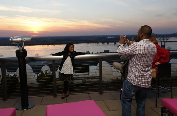 Family at Twilight Sky Terrace at the Madison Hotel. Photo Credit: Justin Fox Burks